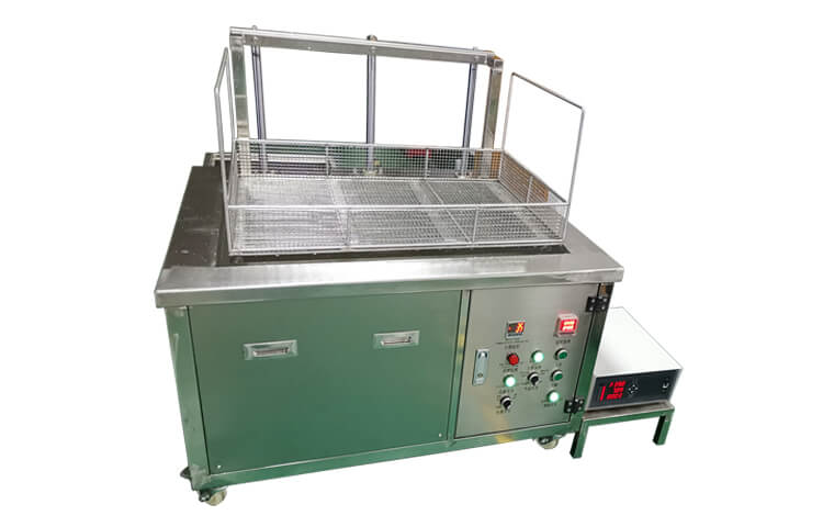 Automated ultrasonic cleaner with lifting system