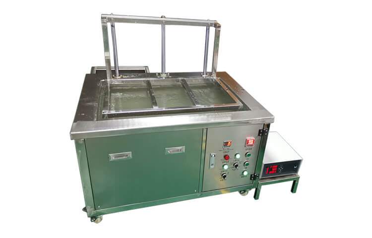 Automated ultrasonic cleaner with lift system
